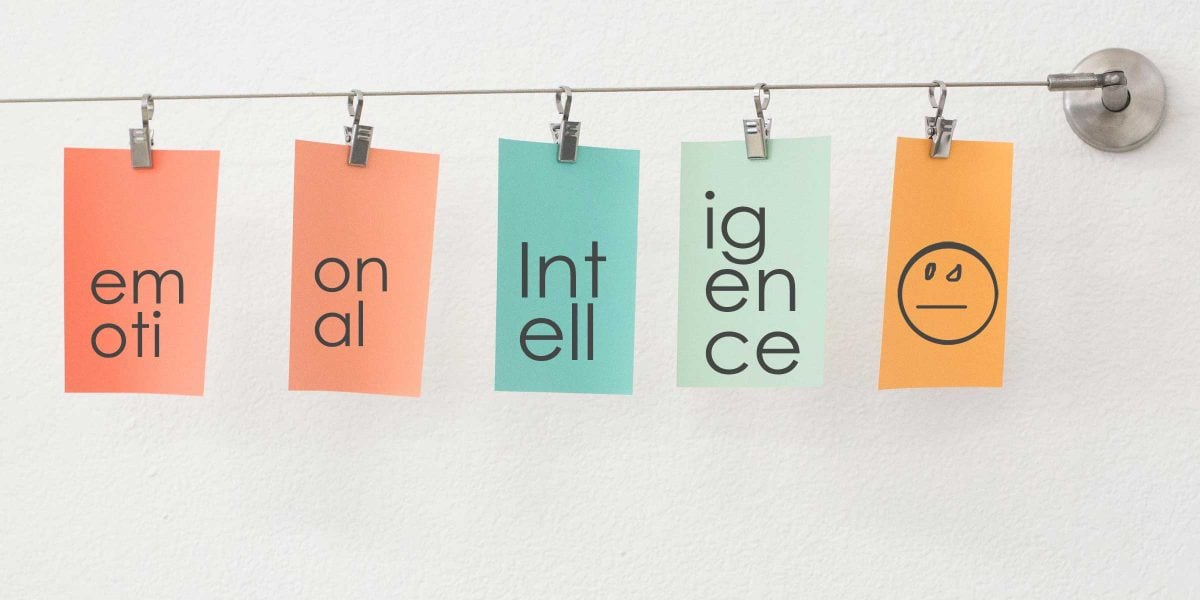 Design cards hanging on a wire, spelling out emotional intelligence.