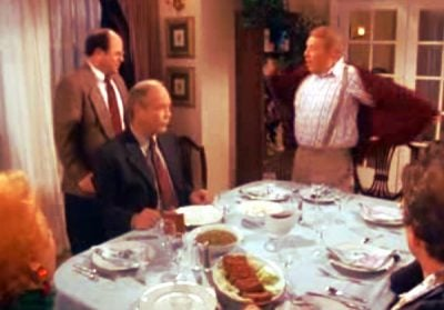 George Costanza and his father stand up during a tense interaction at the dinner table
