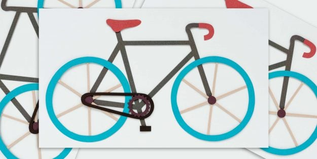 A felt art rendering of a several bicycles, with one in the middle.