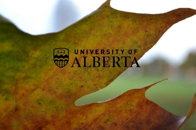 University of Alberta over top of an autumn leaf
