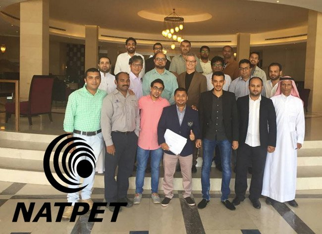 David Cory poses with 22 plant managers with NATPET