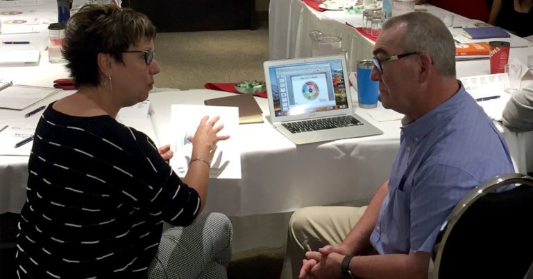 Mike Walters, EQ Coach, has a conversation with a woman from a certification course.