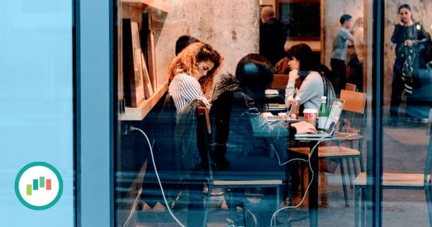 Women working and collaborating in a coffee shop.